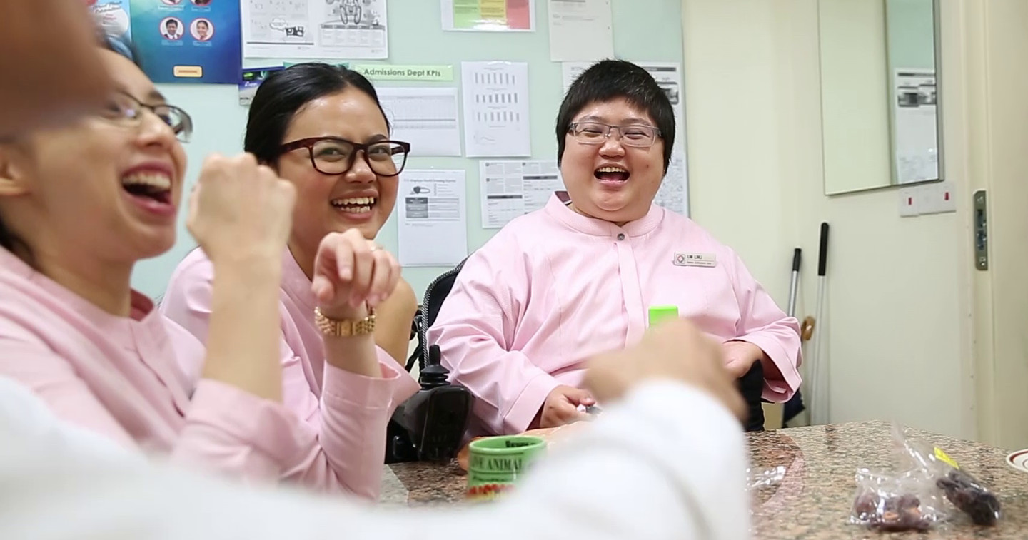 KKH co-workers chatting and laughing happily