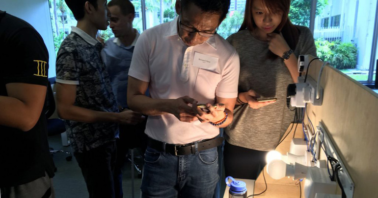 Various individuals testing out some Smart Home devices