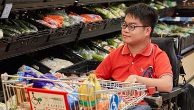 A young man shopping for groceries at the supermarket