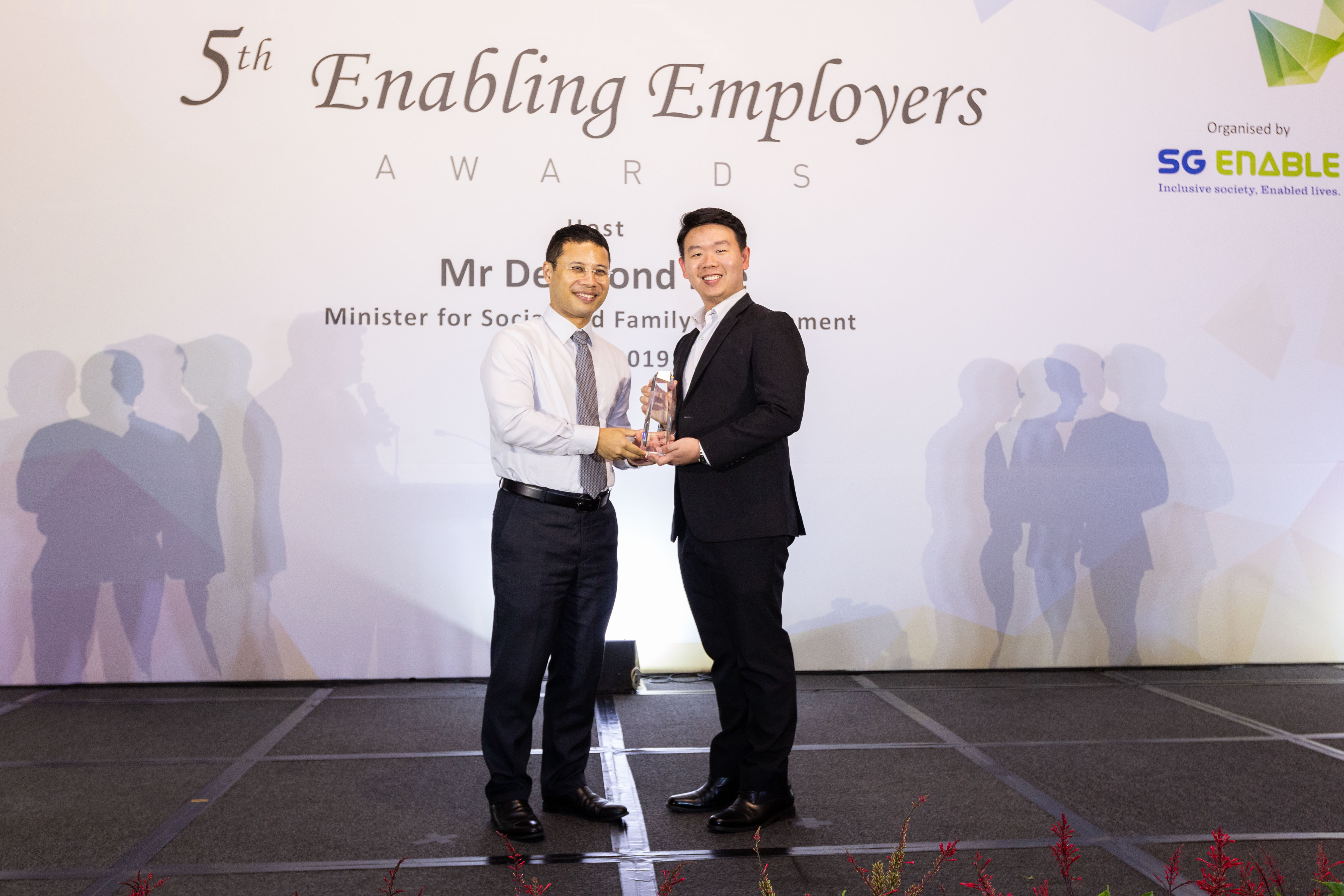 Benjamin (right) receiving the Enabling Champion Award at the 5th Enabling Employers Awards from Minister for Social and Family Development Desmond Lee.