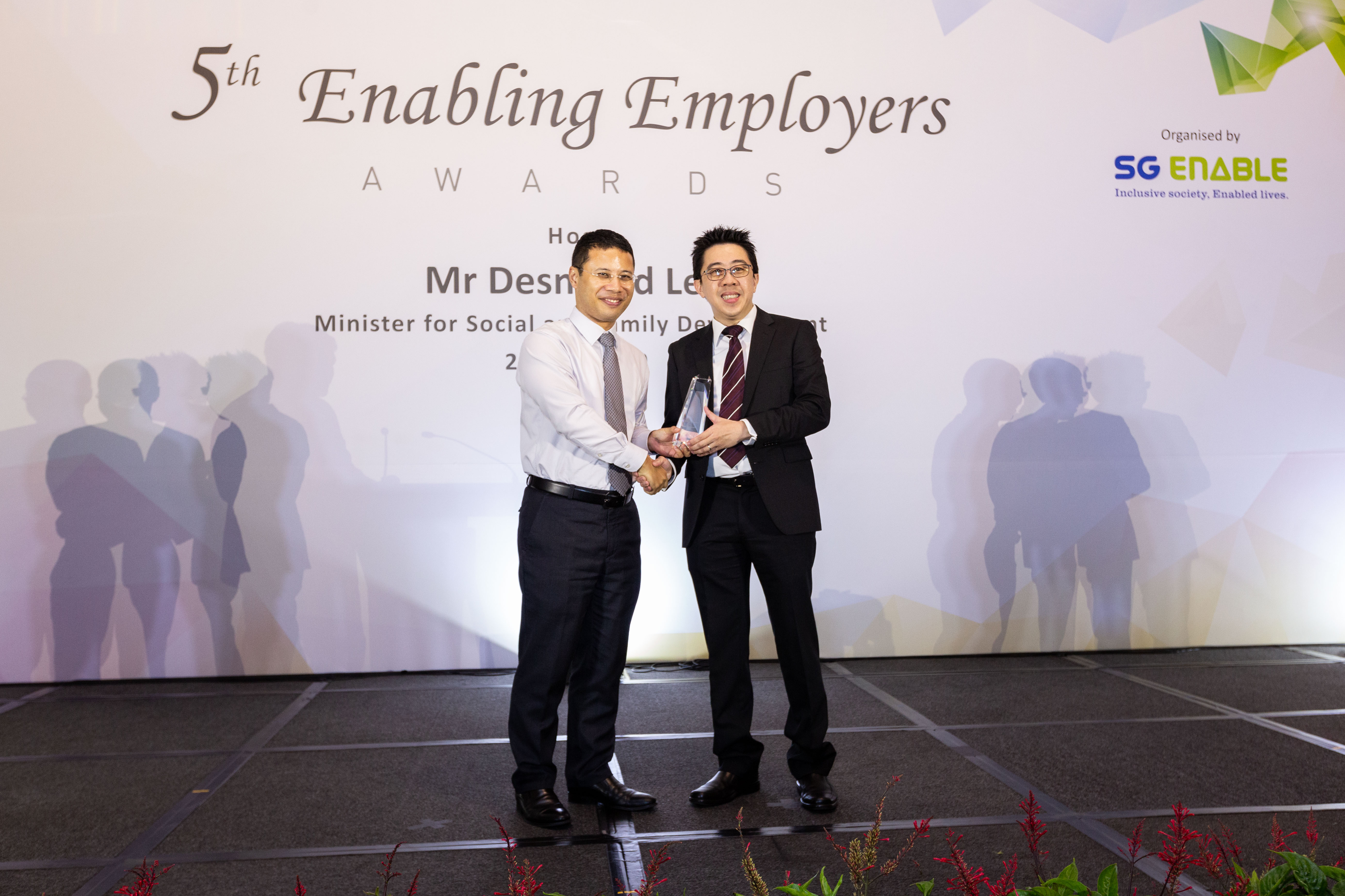 George (right) receiving the Enabling Champion Award at the 5th Enabling Employers Awards from Minister for Social and Family Development Desmond Lee.