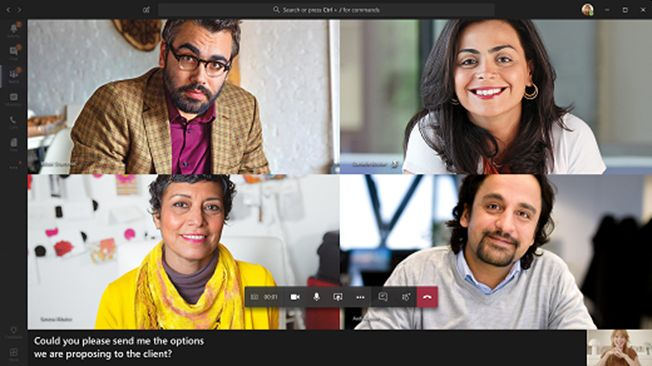 """Screenshot of Microsoft Teams video conferencing platform with 4 screens of 4 persons in the meeting platform. The bottom left shows live captions displaying, """"Could you please send me the options we are proposing to the client""""."""
