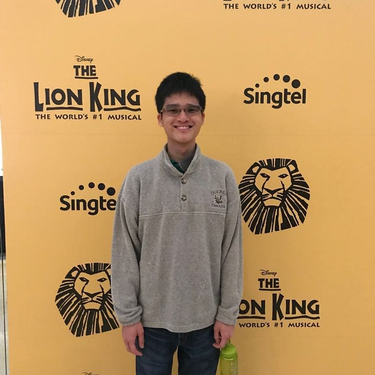 "The photo shows Wesley against the backdrop of a Musical ""The Lion King"""